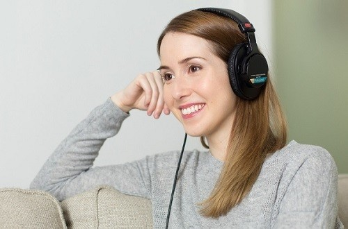 Young Woman Listening To Classical Music