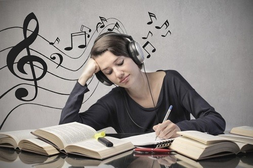 Girl Studying And Listening Music